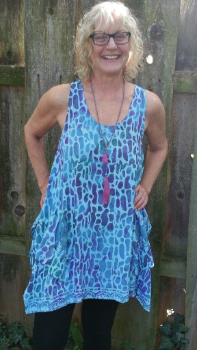 Large rayon tunic with flared sides and 2 puckered pockets in front. $43