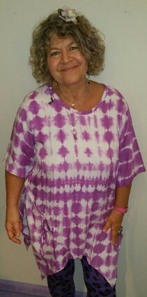 Roomy tie dye tunic with big pockets in front with tie up detail on sides. $53