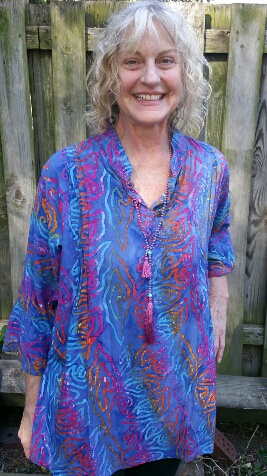 Three button rayon blouse with vertical pin tuck sewing on front. Size Large. $33