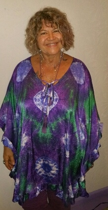 Tie dye caftan of silk/rayon blend. Narrow ruffle around perimeter. Very roomy free size. $45