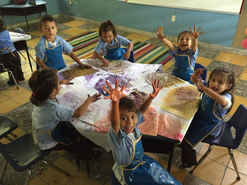 Painting with friends in 'kinder' (preschool) (Josefina is in the front)