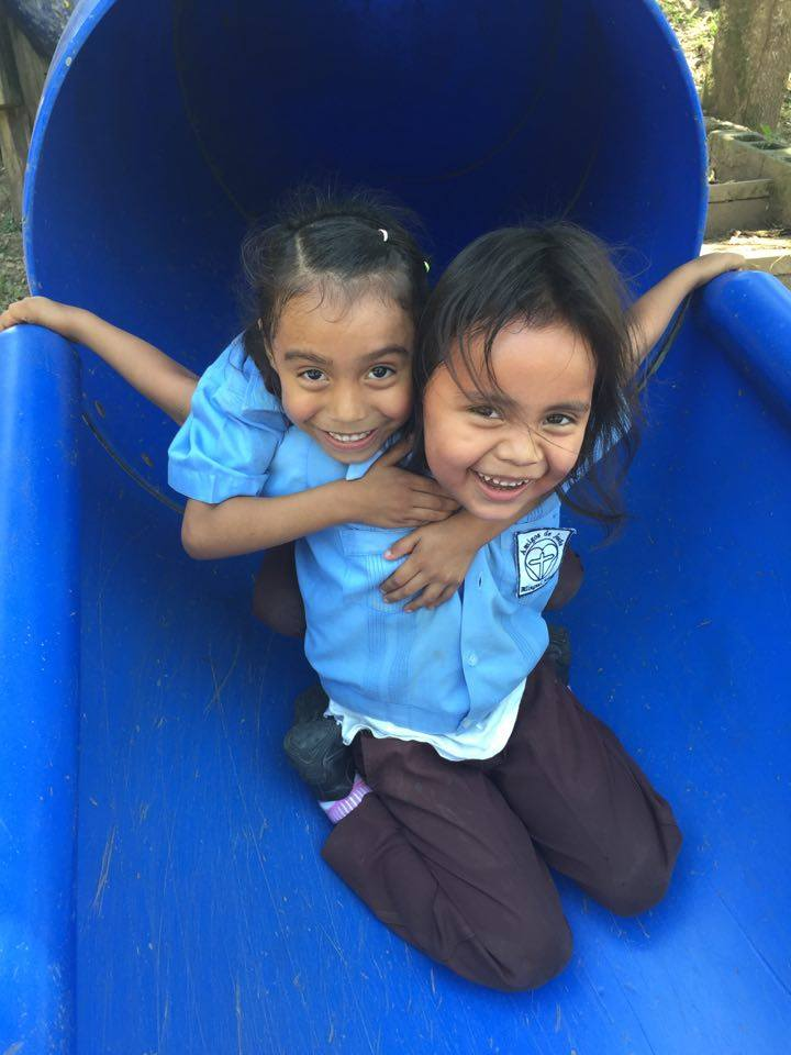 Josefina and friend play on the slide