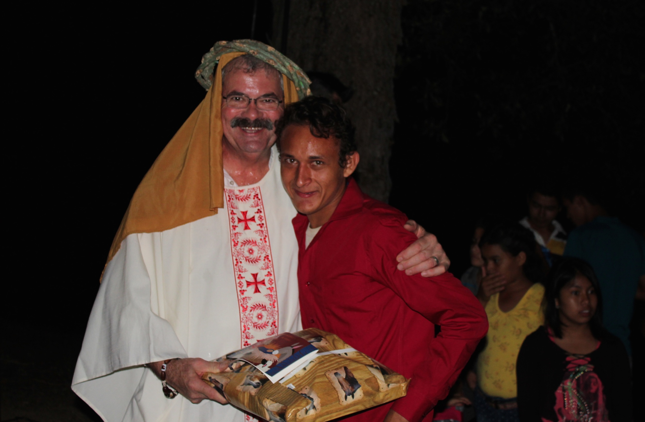 Melvin receiving his present on Three Kings Day (January 6th) from one of the 'Three Kings,' board member Rob Fenza.