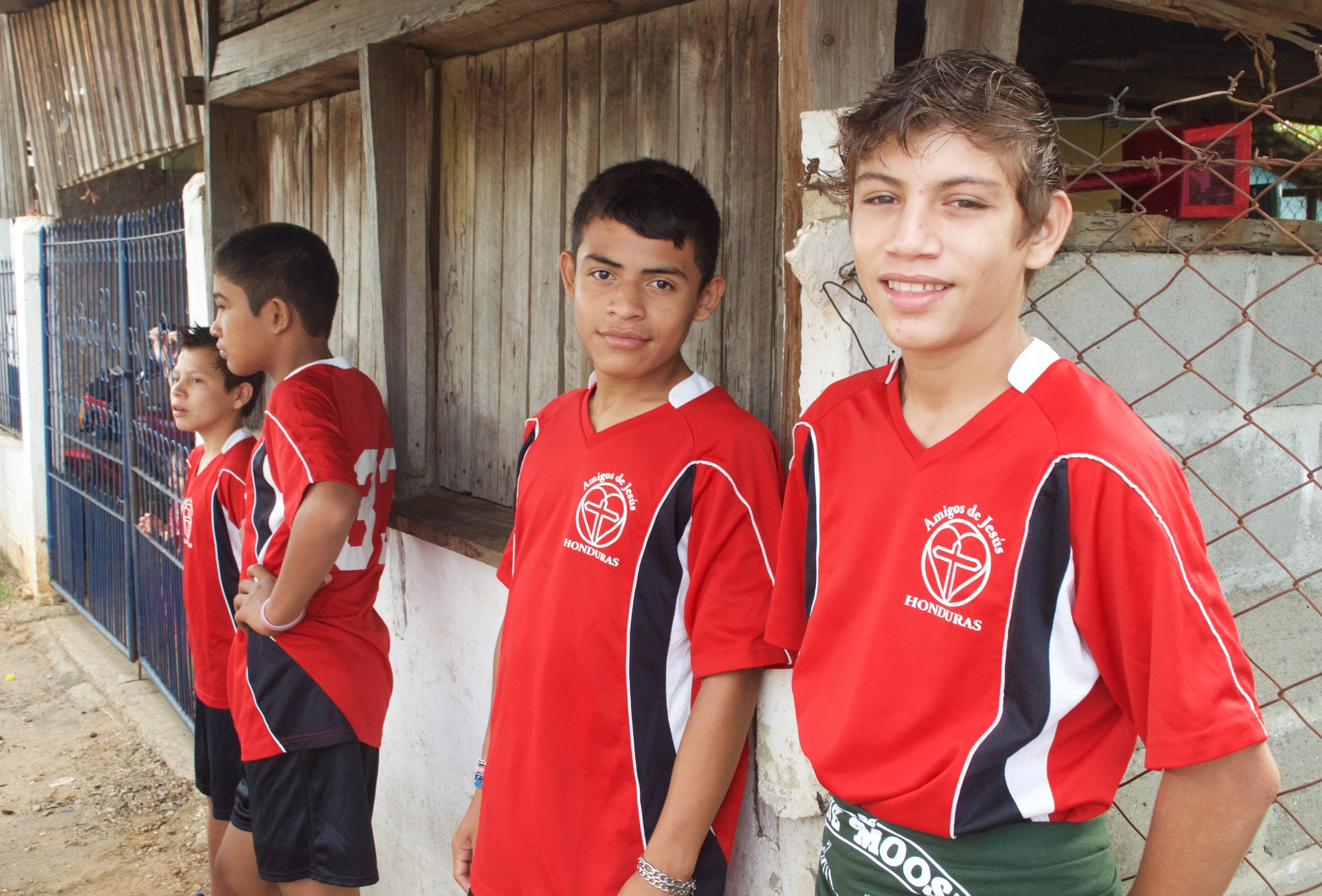 Andres (second from right) and friends pose at a soccer game.