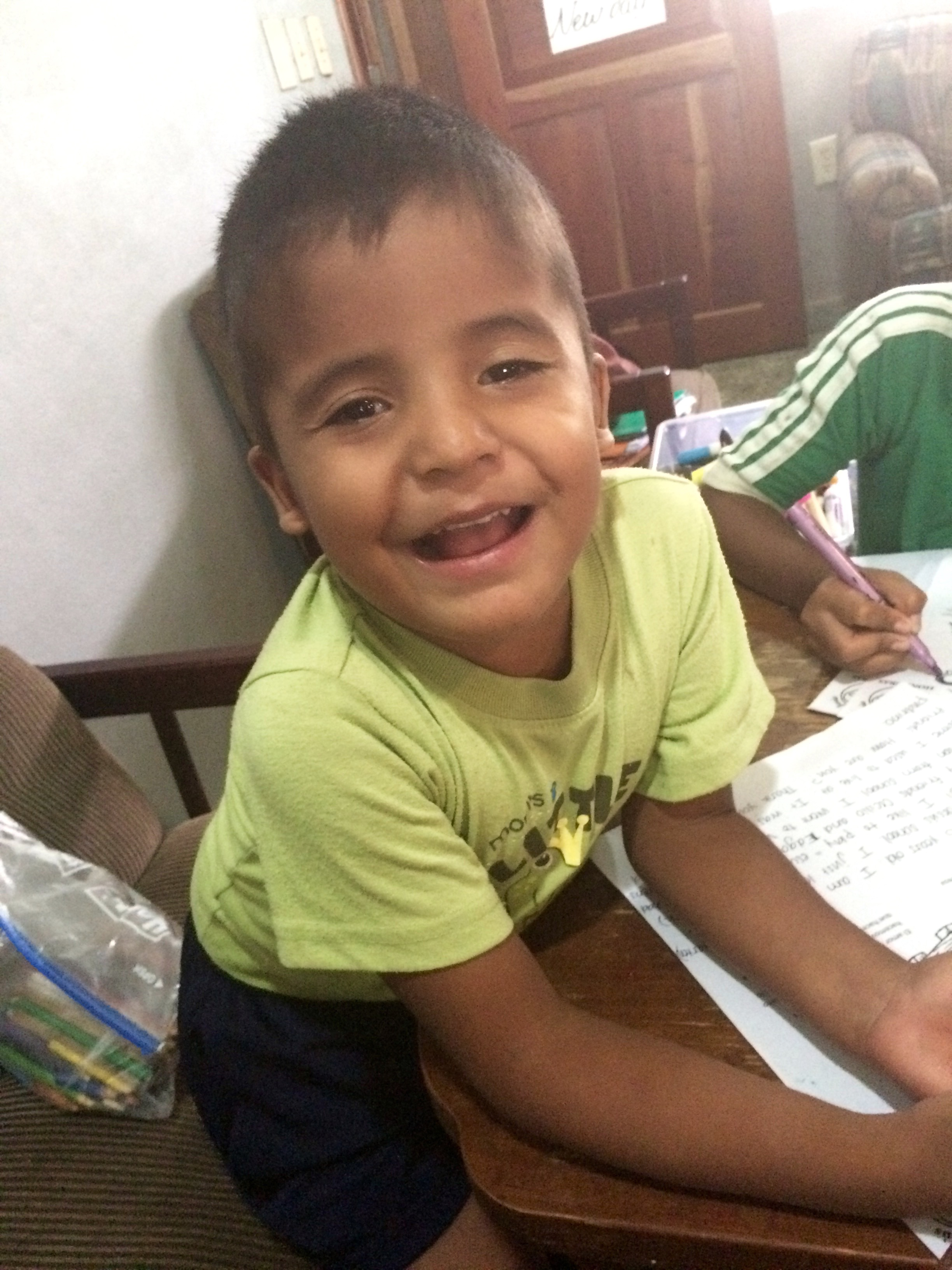 Isaac while writing letters to his sponsors in the U.S.