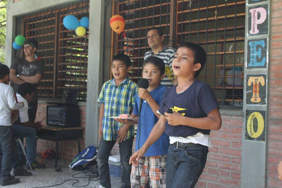 Jason* (center) and friends doing karaoke during the celebration of Dia del Niño (Day of the Child) on September 10th