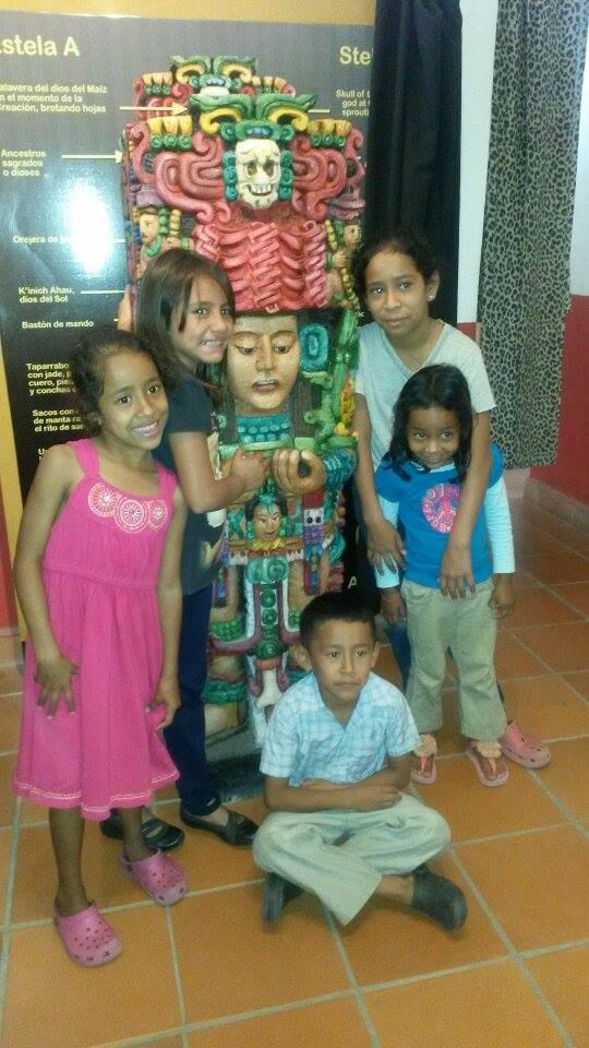 Kira (blue shirt), her 3 older siblings, and a friend (black shirt), visiting the Mayan ruins in Copan Ruinas, Honduras.