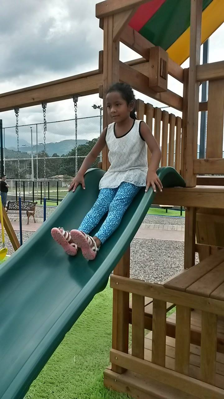 Kira trying out a fancy playground during her vacation trip in October.