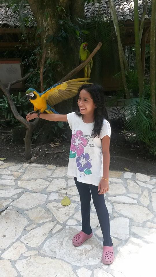 Holding the 'guacamaya,' the national bird of Honduras, while on October vacations last year.