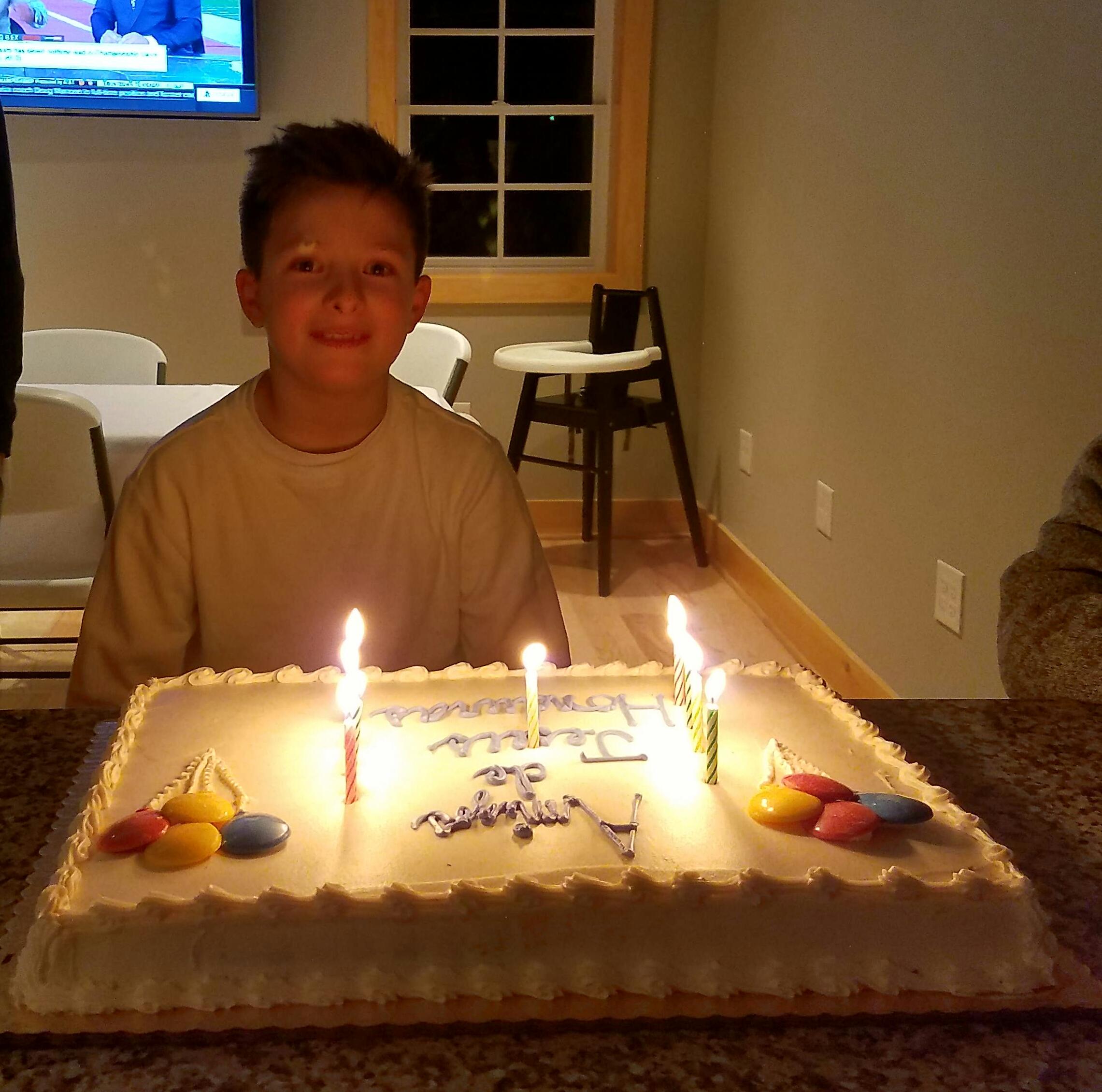 "Christopher's special birthday cake that says, ""Amigos de Jesús!"""