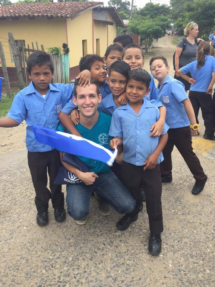 Claudio* (front right) with Mr. Sean and friends at the local parade for Honduran Independence Day.