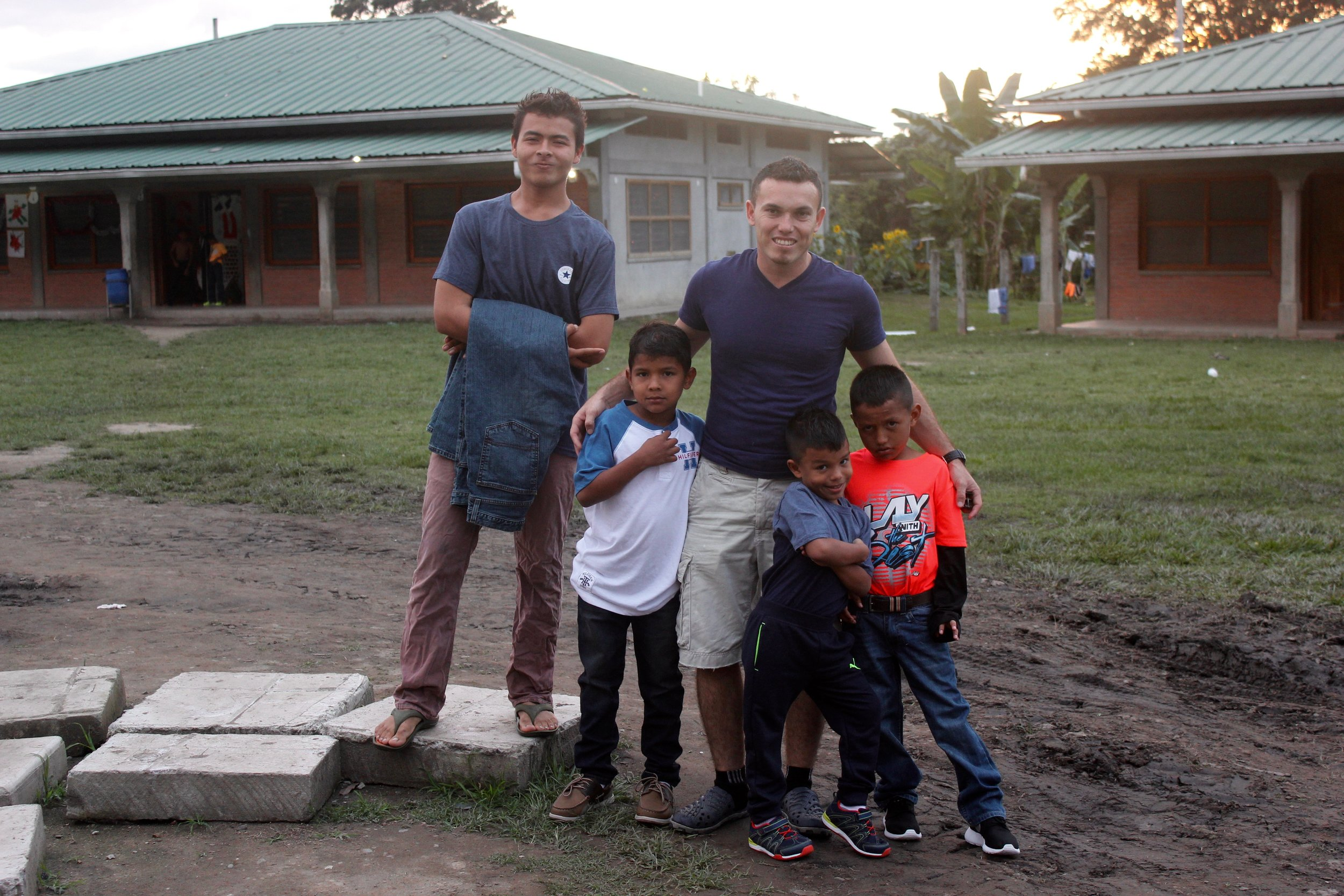 Claudio (second from left) on Christmas with Padrino Antonio and other boys from his dorm.