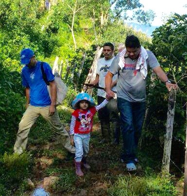 Humberto walking with one of our girls and one of the  jovenes  from wood shop (blue shirt).