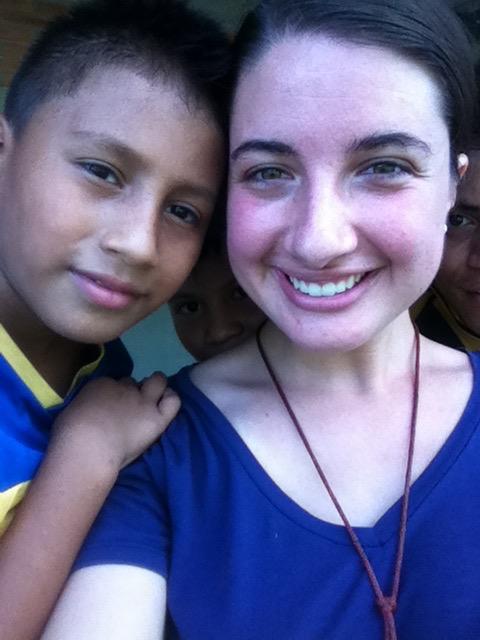 Esteban with volunteer Miss Ashley.