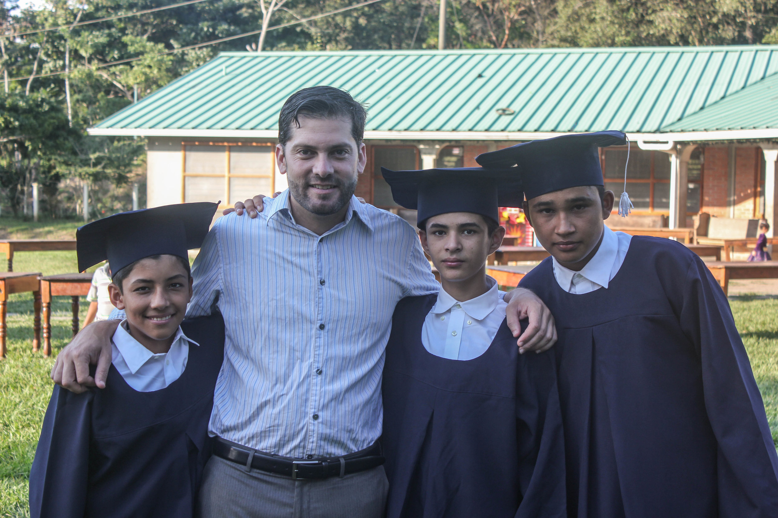 Adán (right) with Pato and his fellow classmates at his 6th grade graduation in December 2016