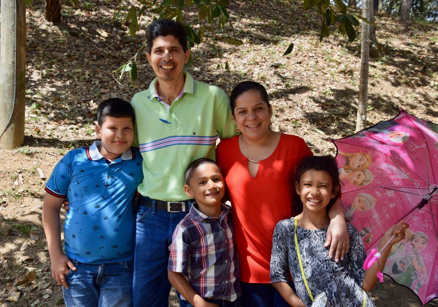 Felipa (right) and her brother (center) with a neighborhood family from the Amigos School,who has taken the two under their wing, visiting them every year on Visitors Day and sometimes even inviting them to their house on weekends.