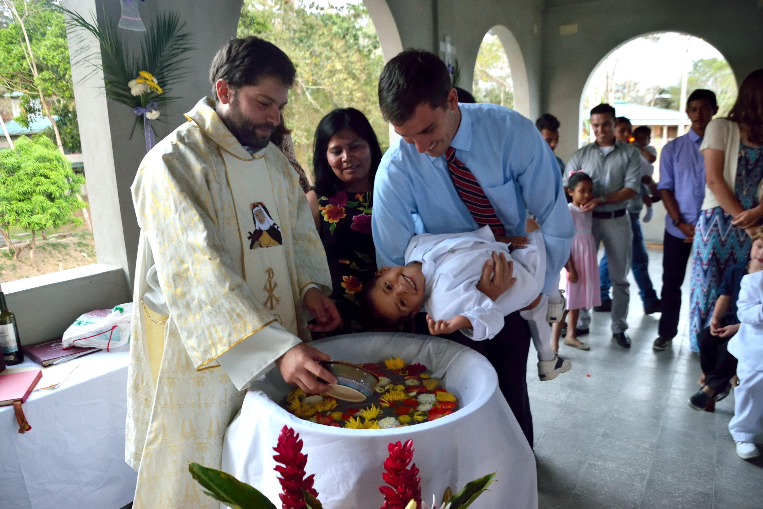 Alan with his godchild, one of our newest children, at the Easter mass in April 2017.