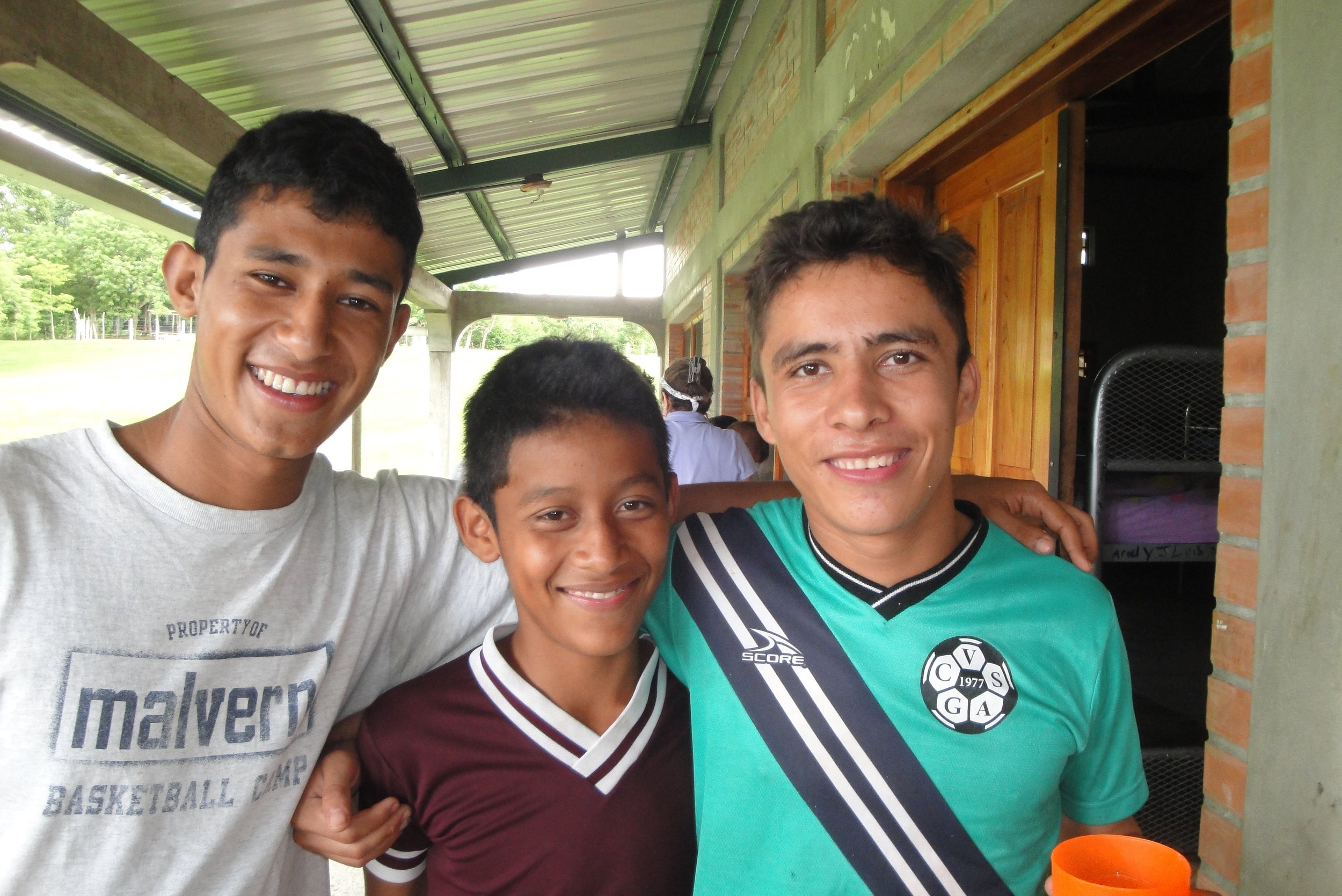 Santino (in the middle) with two friends.