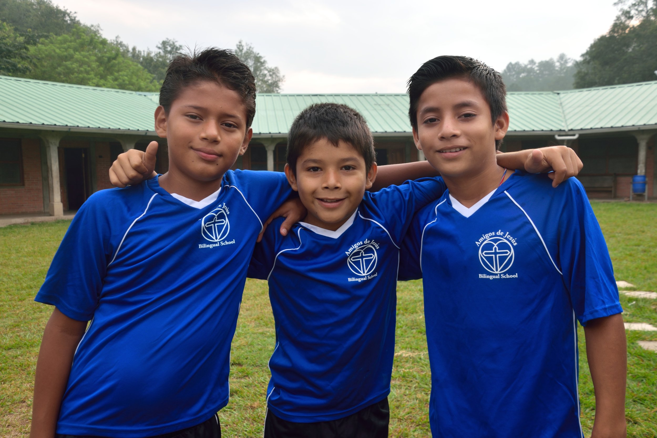 Jason, pictured in the middle, with two of his friends at the 'hogar' before the Honduran Independence Day Parade this past September. He is now in 6th grade at our bilingual school.