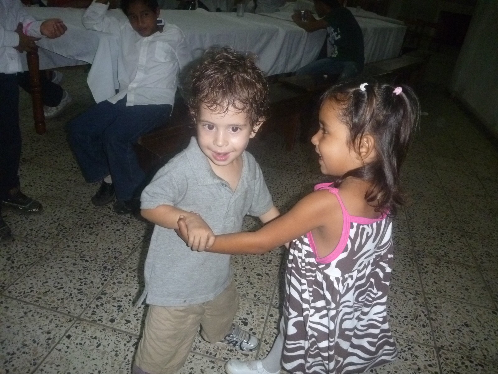 Perla dancing with Thomas (son of Amy and Wilson Escoto, Co-Directors of Operations)when they were little. Even though they are older now, they are still close friends!