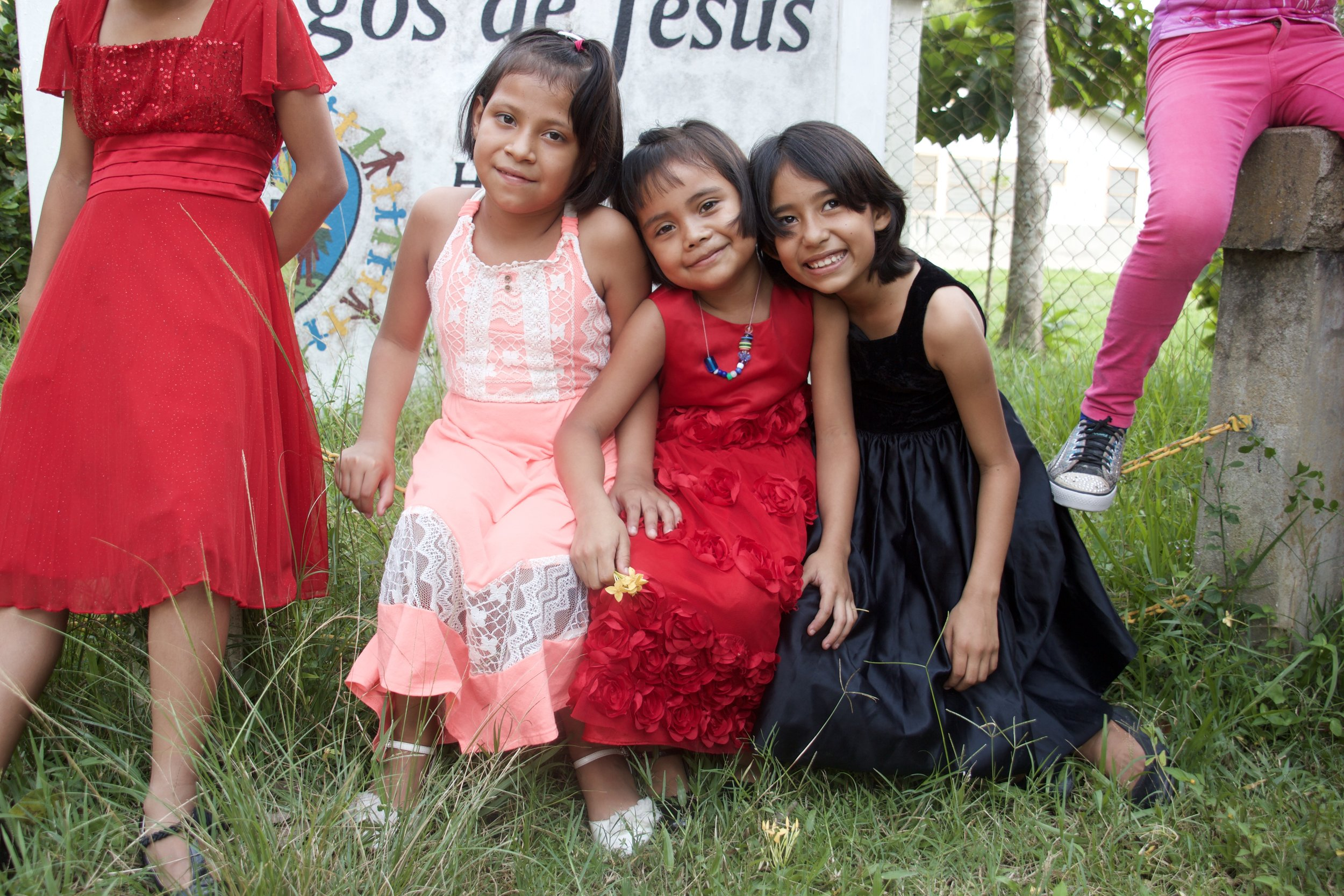 Perla (in the black dress on the right) with two of the other girls in her dorm.