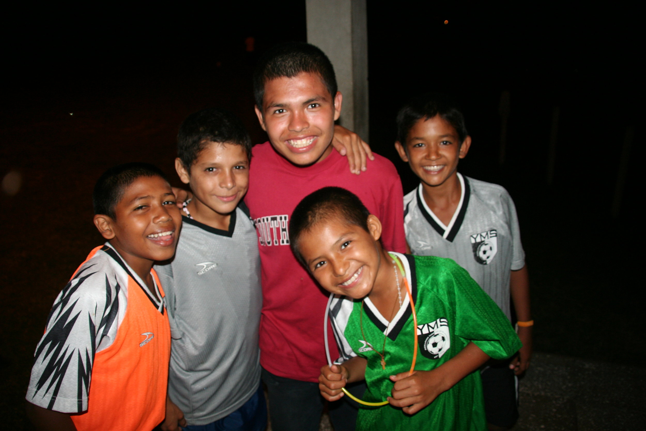 Vicente (pictured in the green shirt to the right) and friends posing for a photo back in 2009.