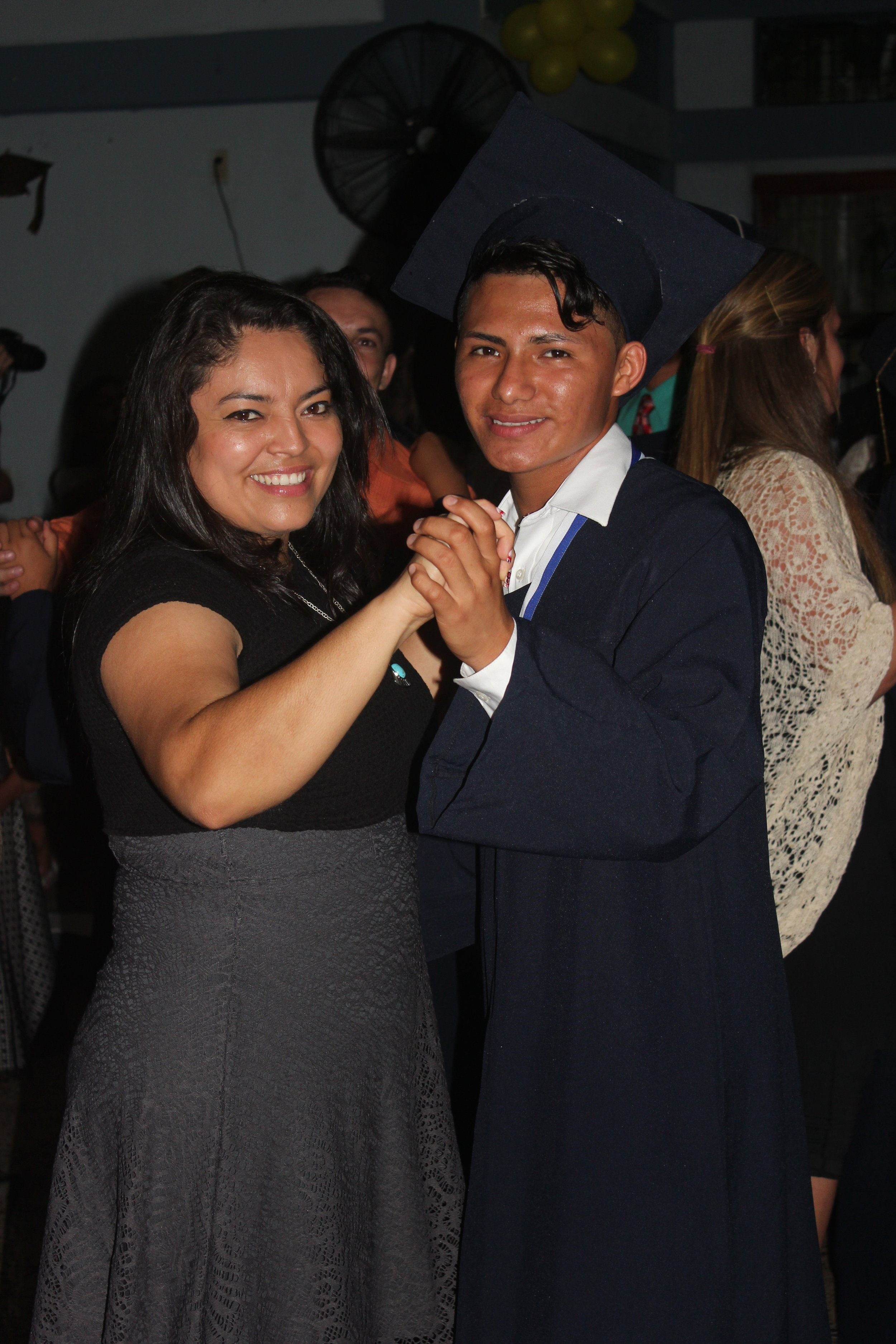 Vicente and his 'madrina' celebrating his graduation from 9th grade in December of 2016.