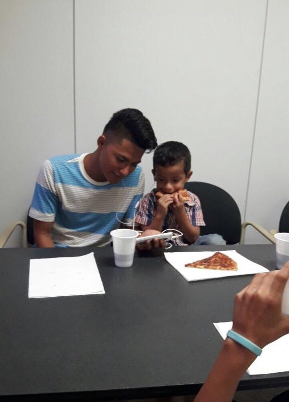 Vicente at the Dental Brigade this past September eating lunch and watching a movie with one of our younger boys.