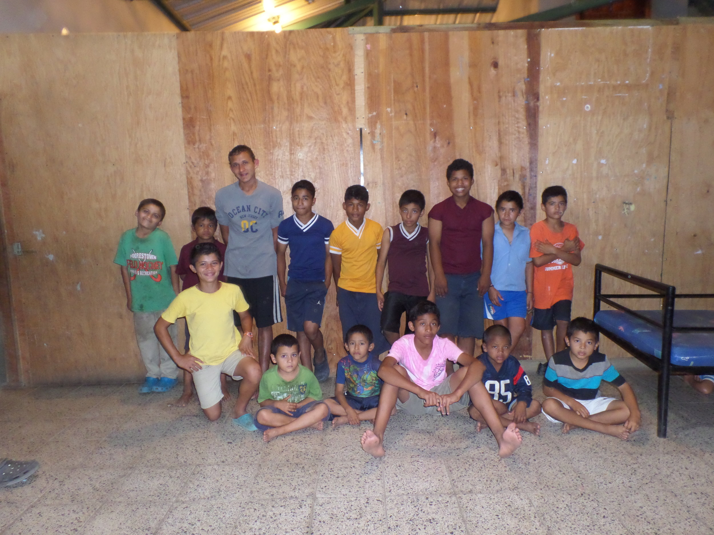 Lucio, pictured standing up in the blue shirt second from the right, and the other boys in his 'hogar' posing for a photo in 2015.