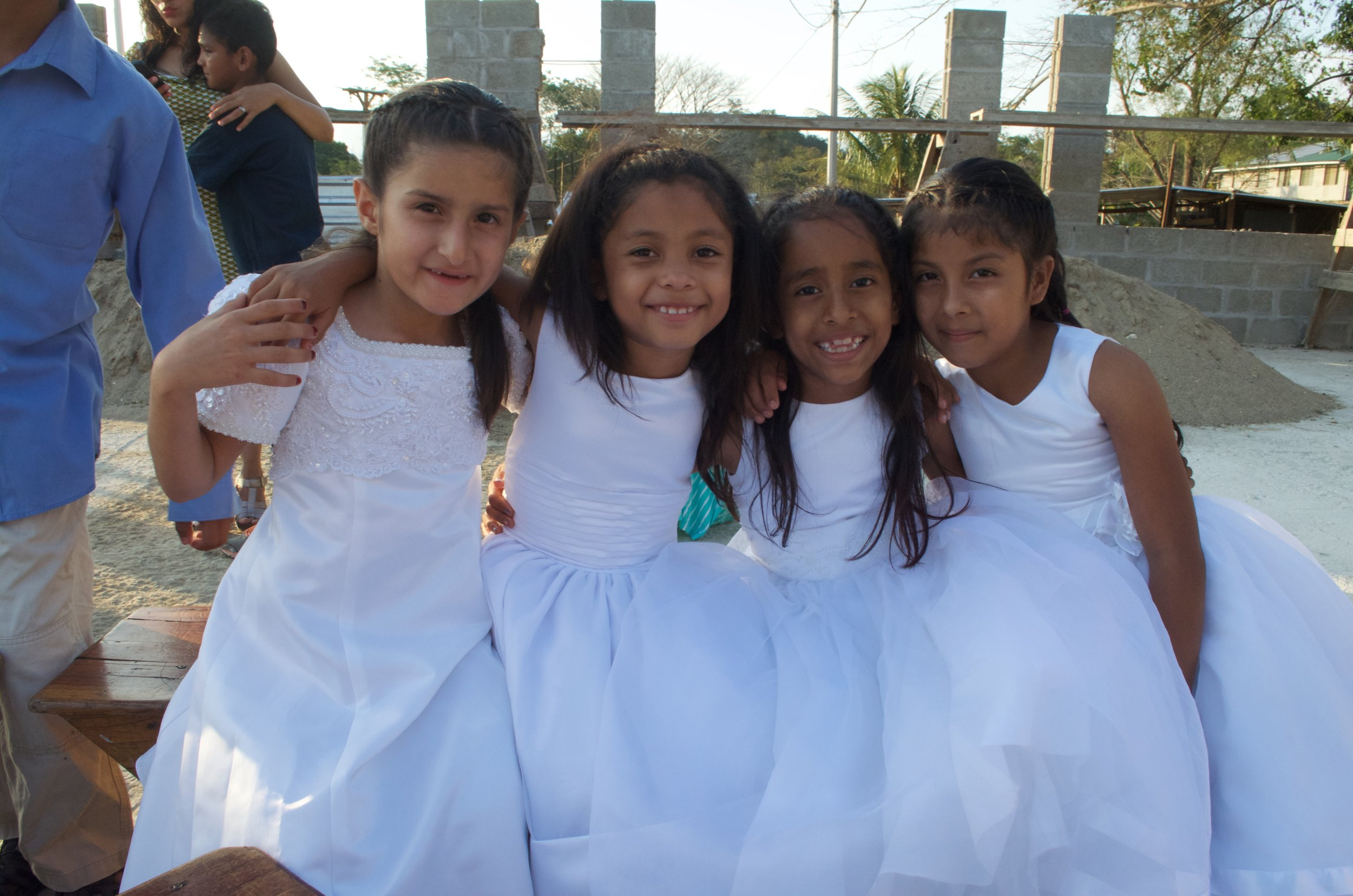 Soledad with several friends posing for a picture before the 2016 Easter Vigil Mass where the four girls received their First Holy Communion.