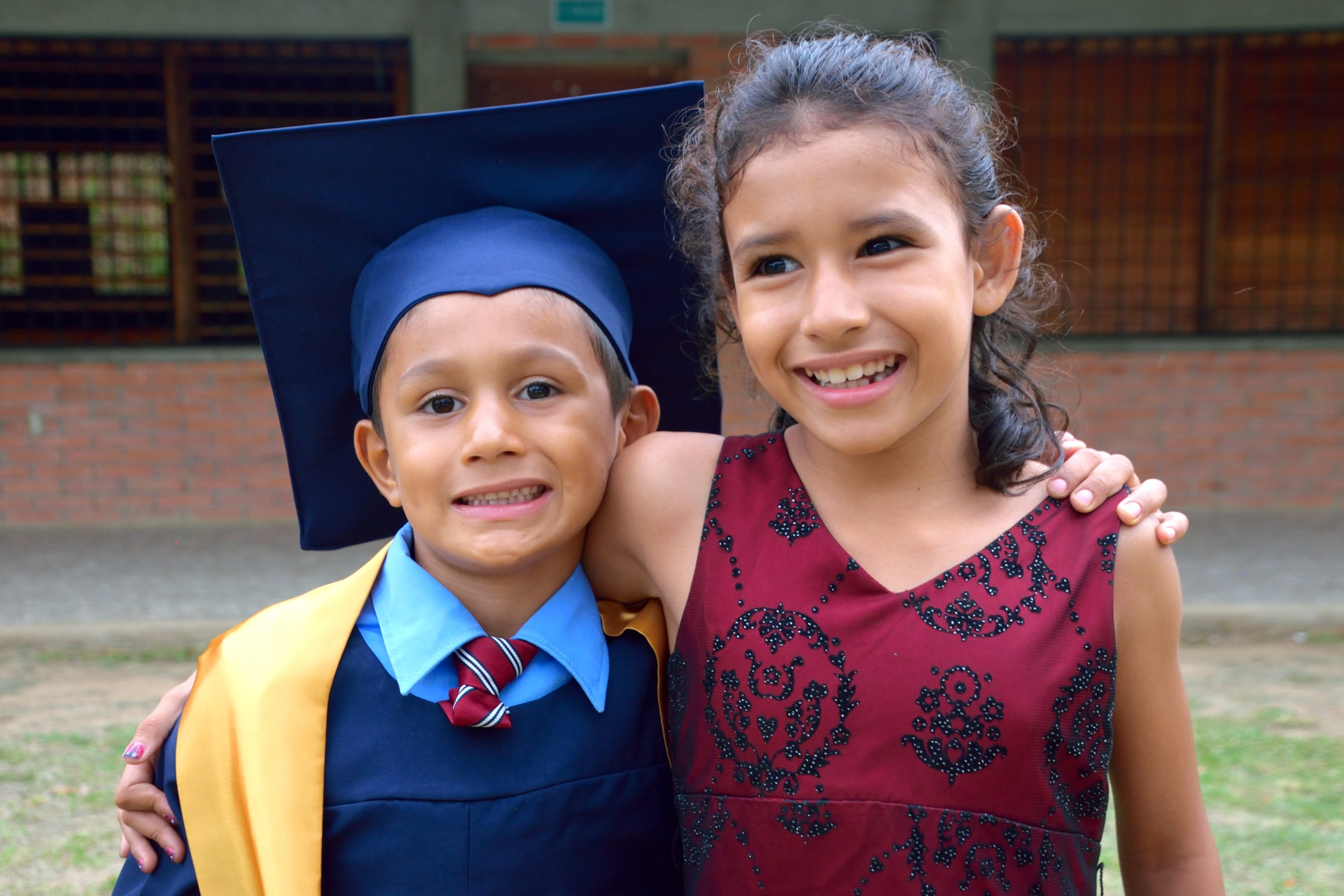 Joaquin and his sister, Felipa,* celebrating his graduation from 'Prep.'