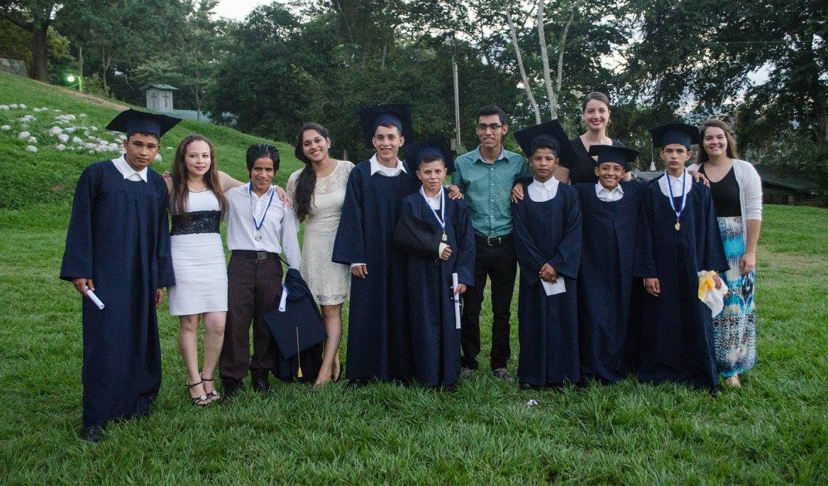 Profe Evelyn (fourth from the left) at the 2016 Graduation Ceremony along with the boys who graduated from 6th grade that year and their other teachers.