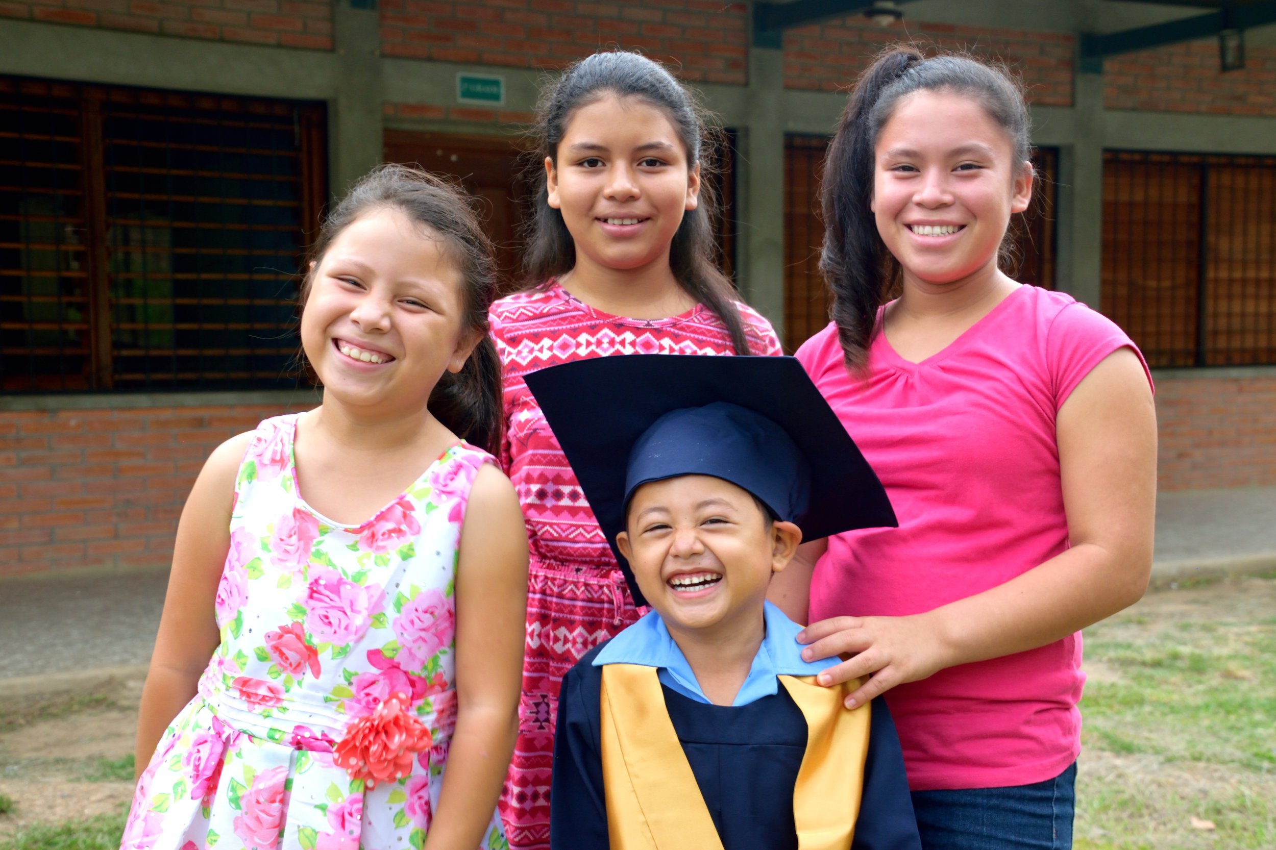 Pictured in the middle, Elisa celebrates her youngest brother's graduation from 'Prepa' (kindergarten) in June of 2017 along with her two sisters.