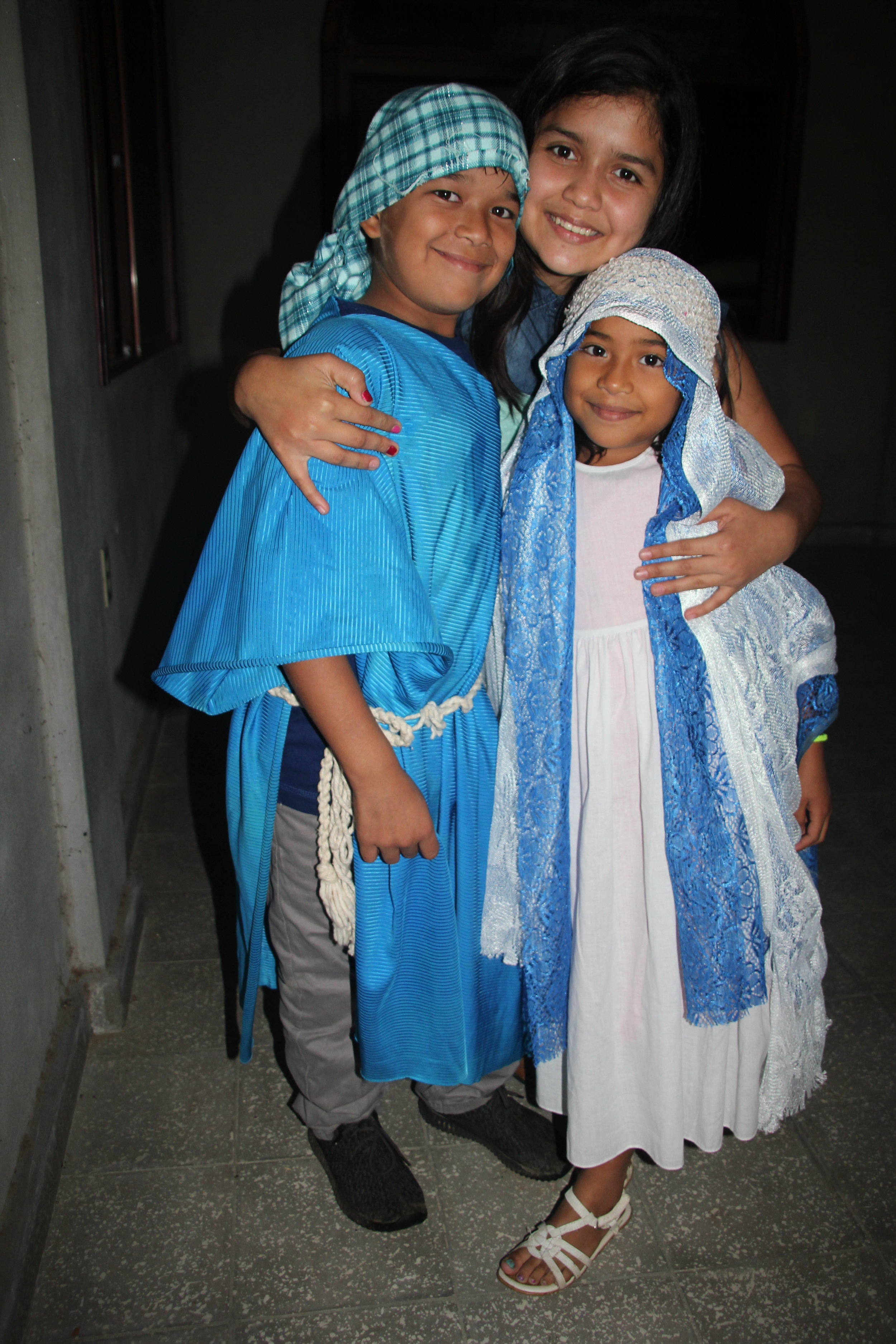 During Three King's Day, or Epiphany, this year, Alanzo and his younger sister played the part of Mary and Joseph. Here they pose with a friend.