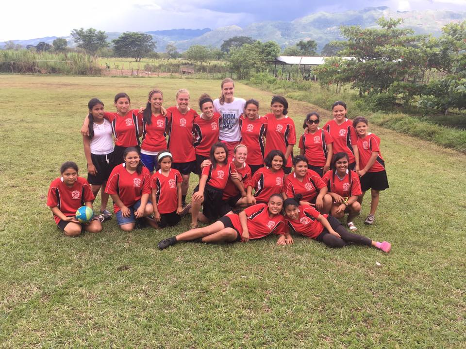 In addition to working at our school, Profe Jeidy is active in our kids lives outside of school. Here she's pictured with several other volunteers, teachers, 'madrinas,' and older girls after a soccer tournament.
