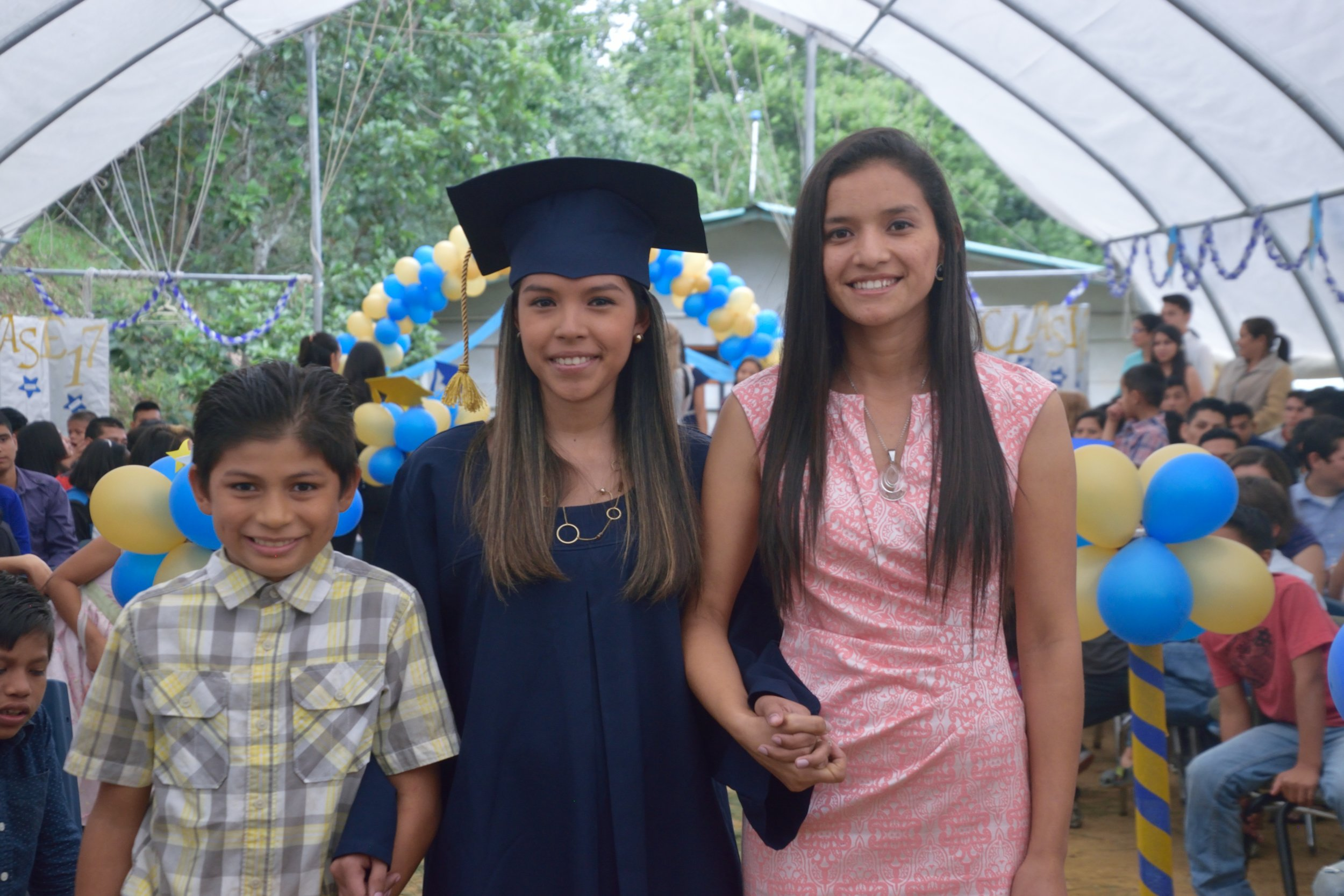 Profe Jeidy, on the right, at our school graduation ceremony last December with one of her fellow teachers and close friends who graduated from university.