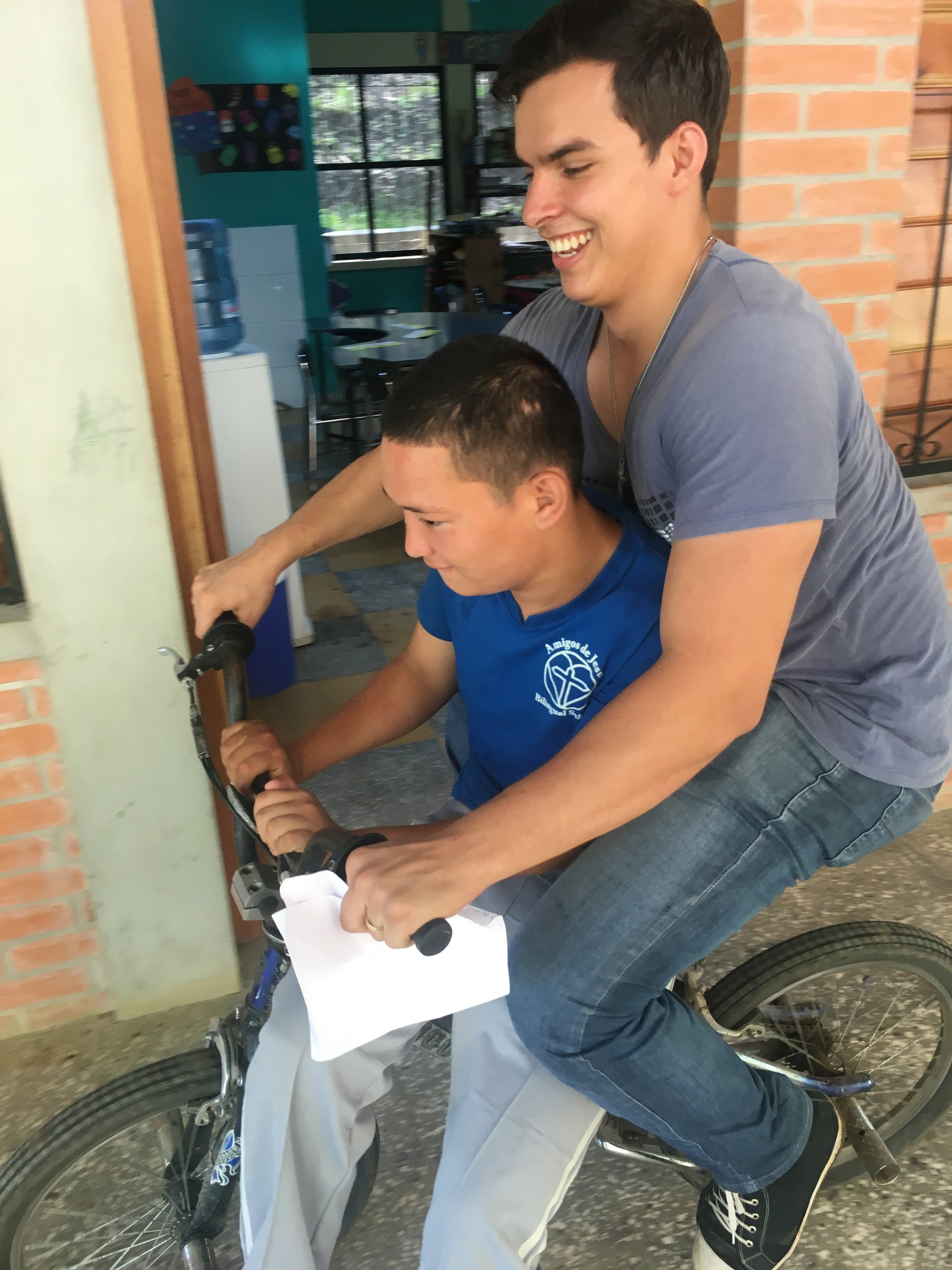 Profe Carlos with one of our young men with special needs. The two have a very close friendship.