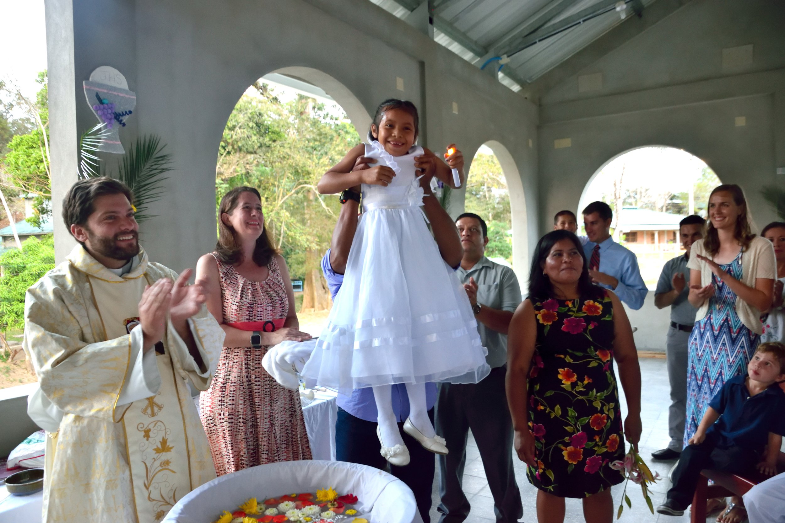 Sara being held up just after at her baptism in during 'Semana Santa' (Holy Week) in 2017.