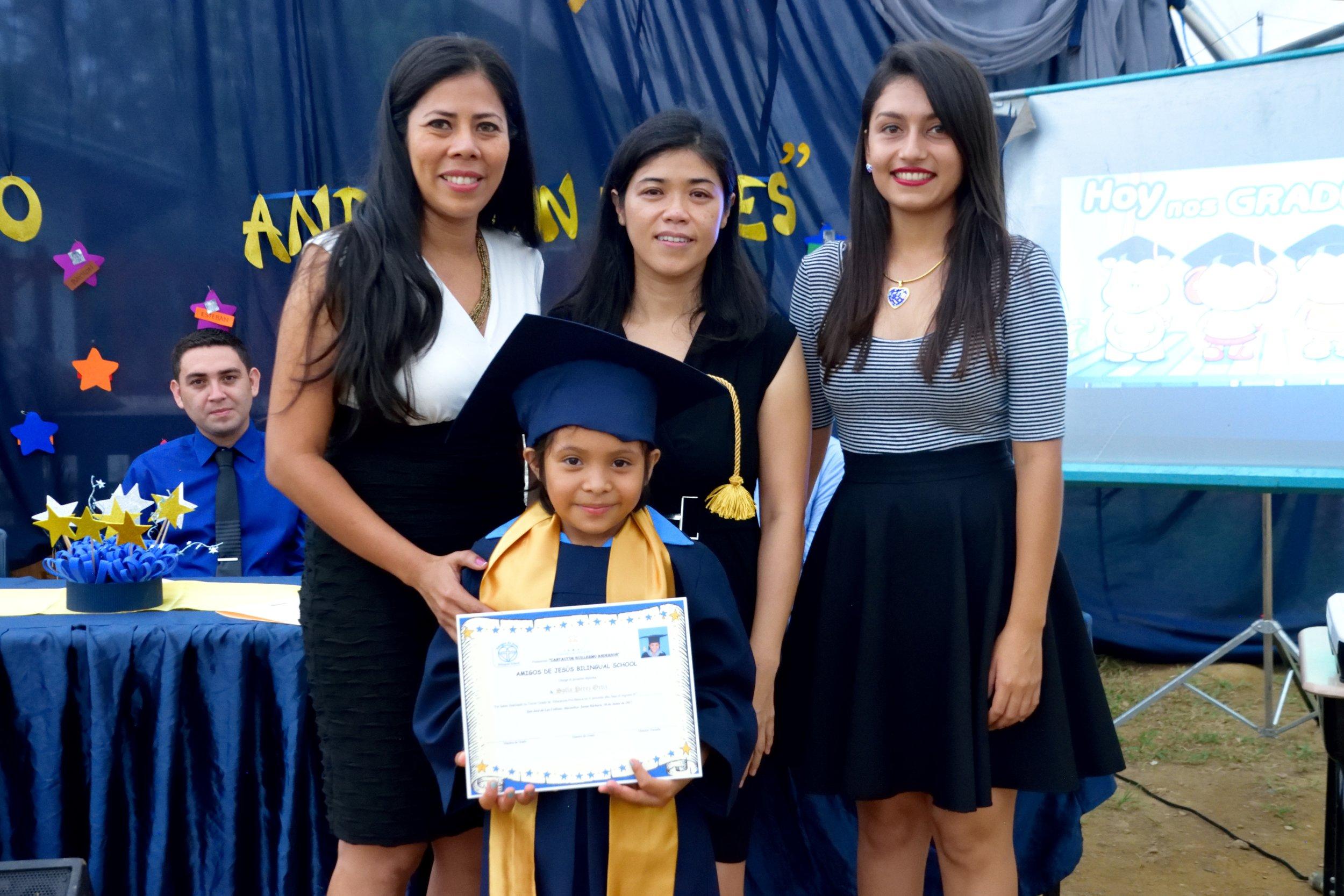 With her three 'Prepa' teachers during graduation last June.
