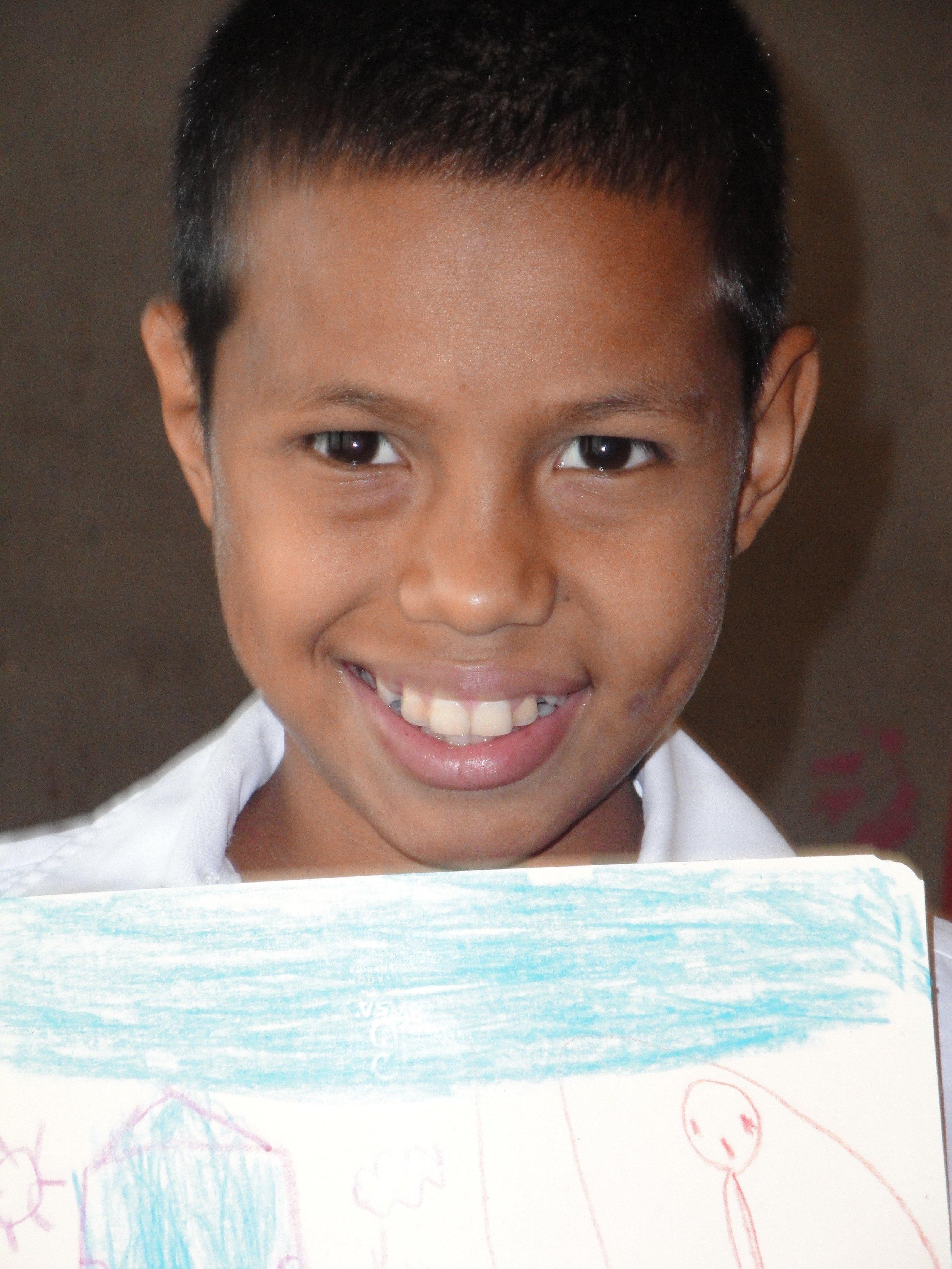 Proud 12-year-old Conrad displaying his art.