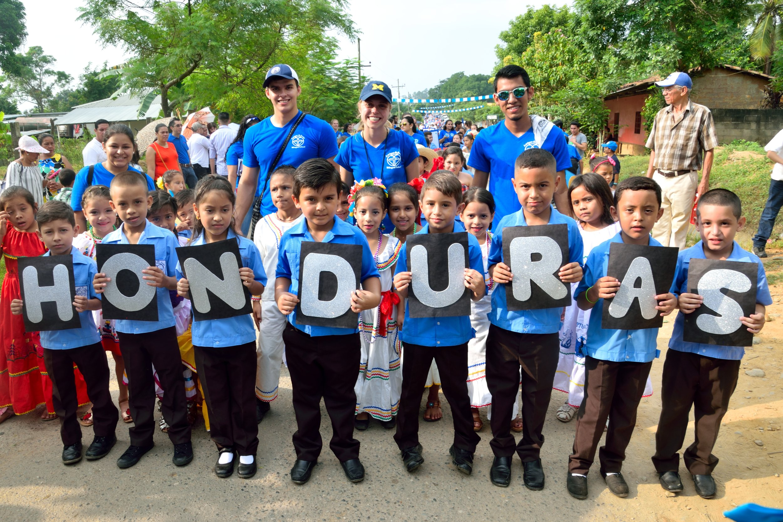 Profe Carlos, pictured in the back row on the left, with the first grade students and teachers during the Honduran Independence Day Parade in September 2017.