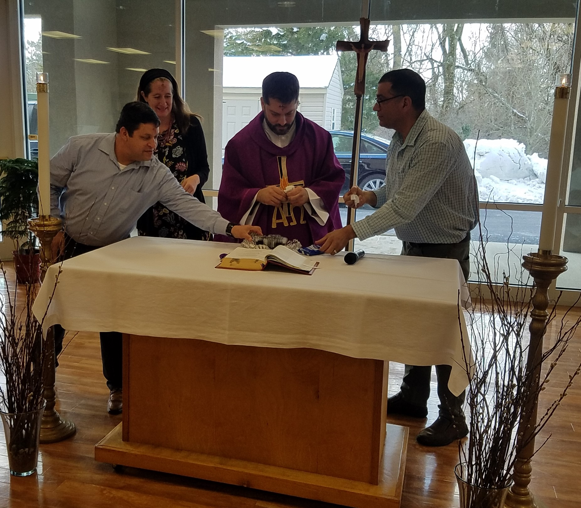 Wilson, Amy, Fr, Patricio, and Anthony bless and prepare the ashes at Ash Wednesday mass