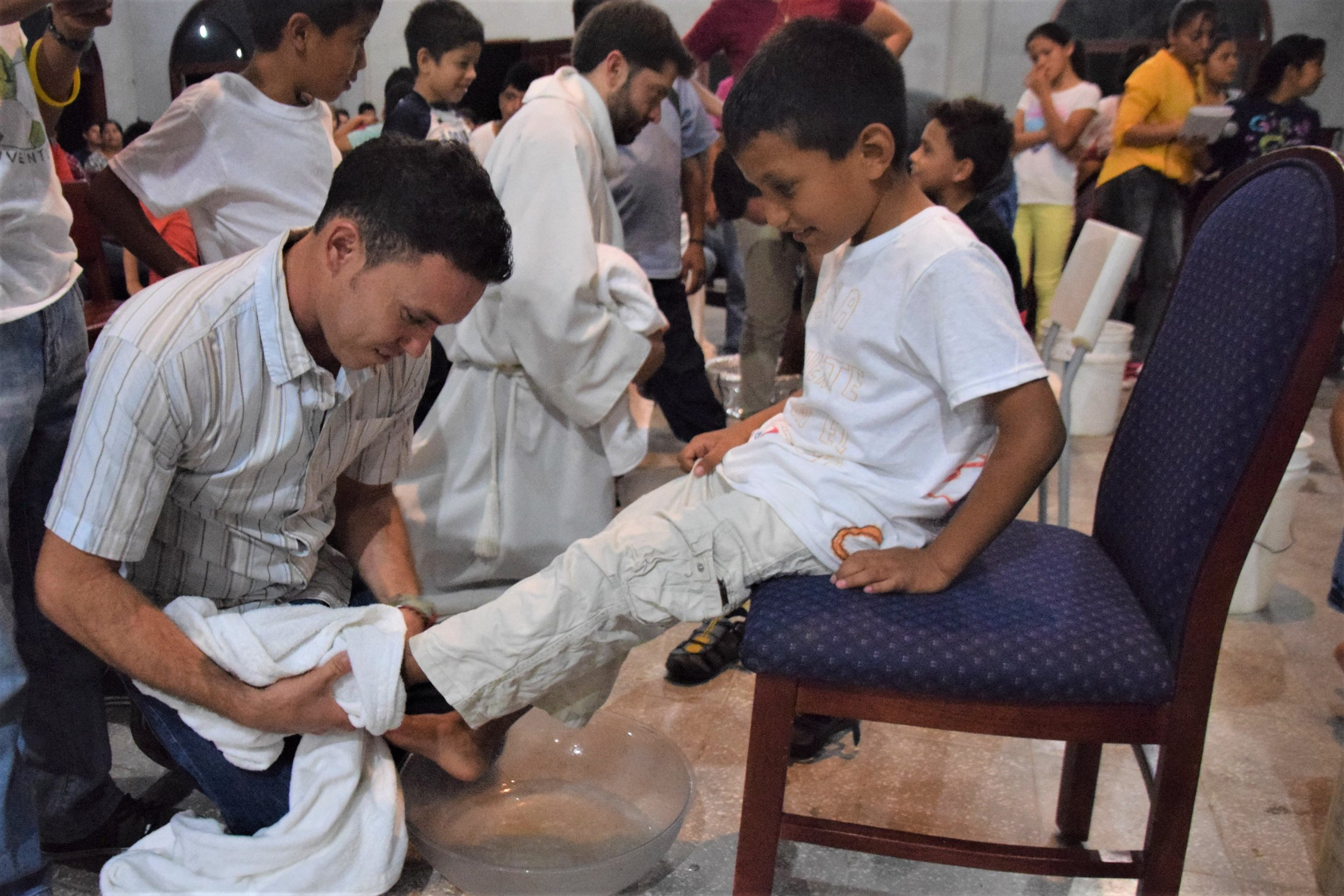 Participating in the washing of the feet on Holy Thursday last year.