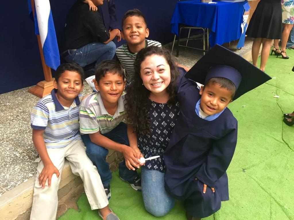 Ignacio's graduation from kindergarten 3 years ago! His brother Damian is seated to the left of Ms. Amelia.
