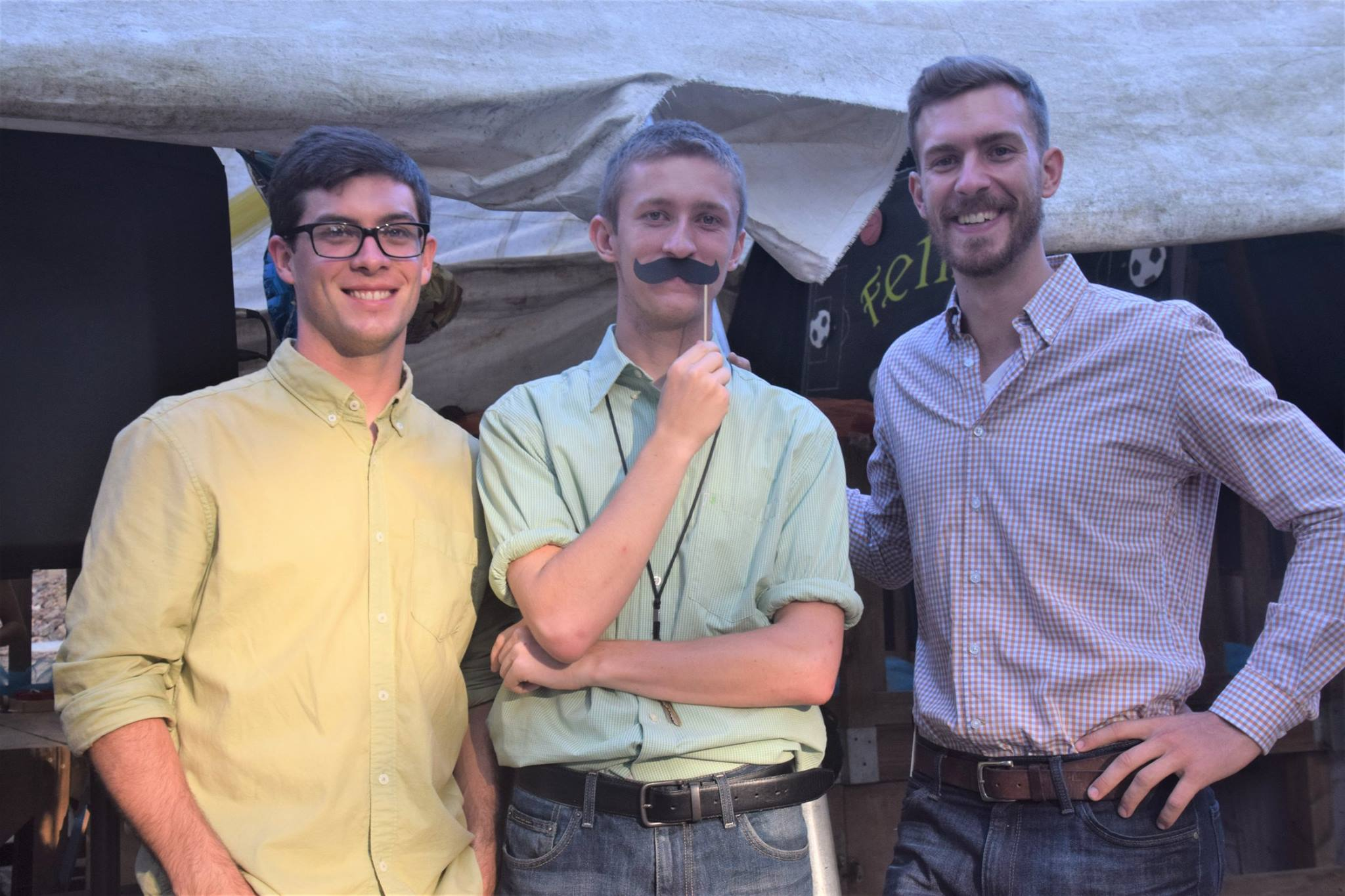 Clay with some of his fellow volunteers enjoying the Father's Day presentations at the school.