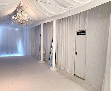luxury-restroom-trailer-chandlier-curtains-450x338.jpg