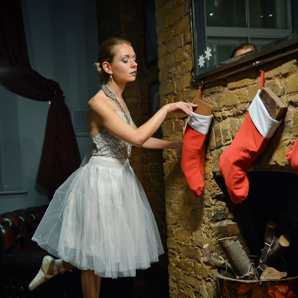 A stardust ballerina slips gifts into stockings for guests...