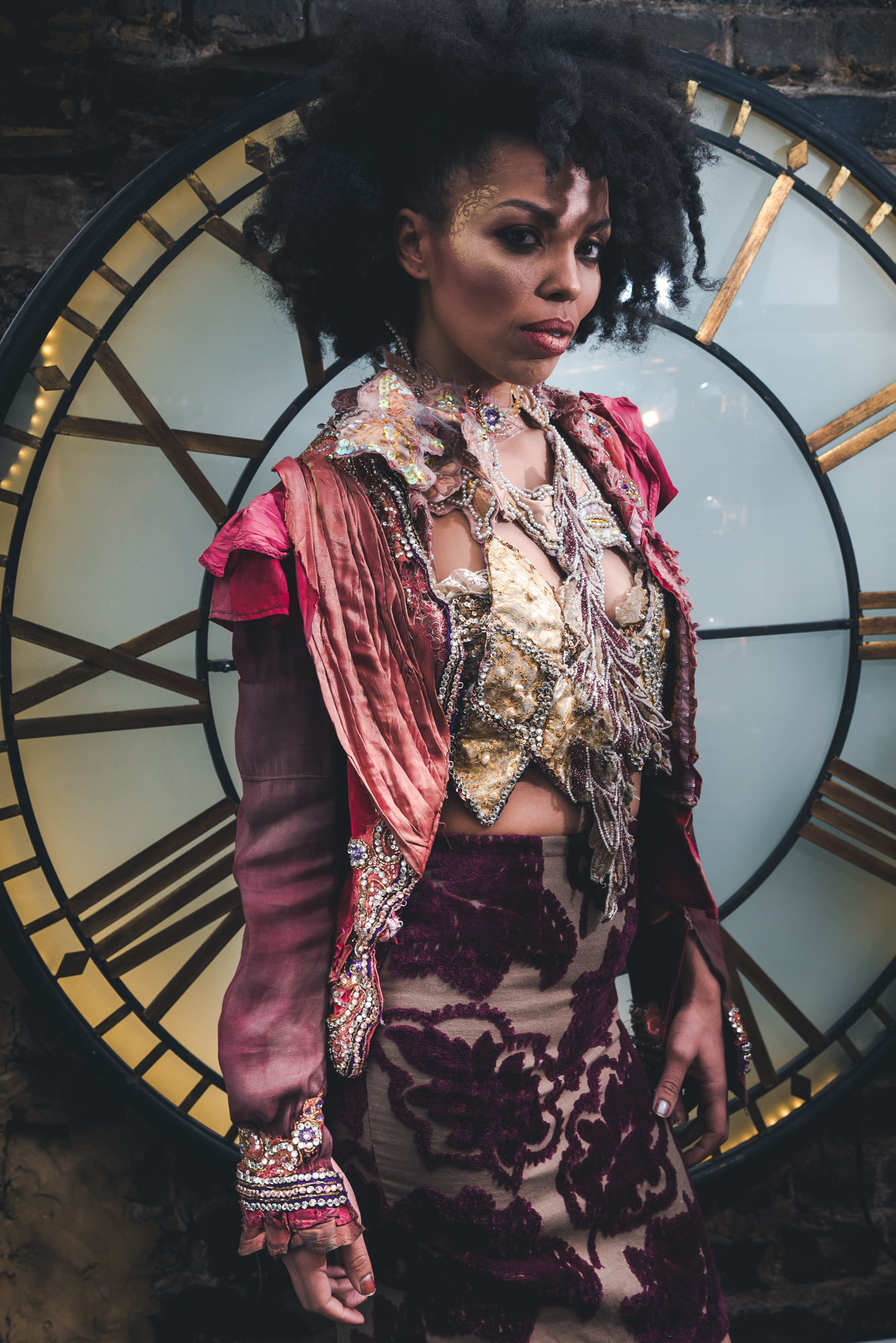 TV Presenter, Journalist and SOAS lecturer Emma Dabiri models the Indian Summer Pink Rococo Suit in The Bardou