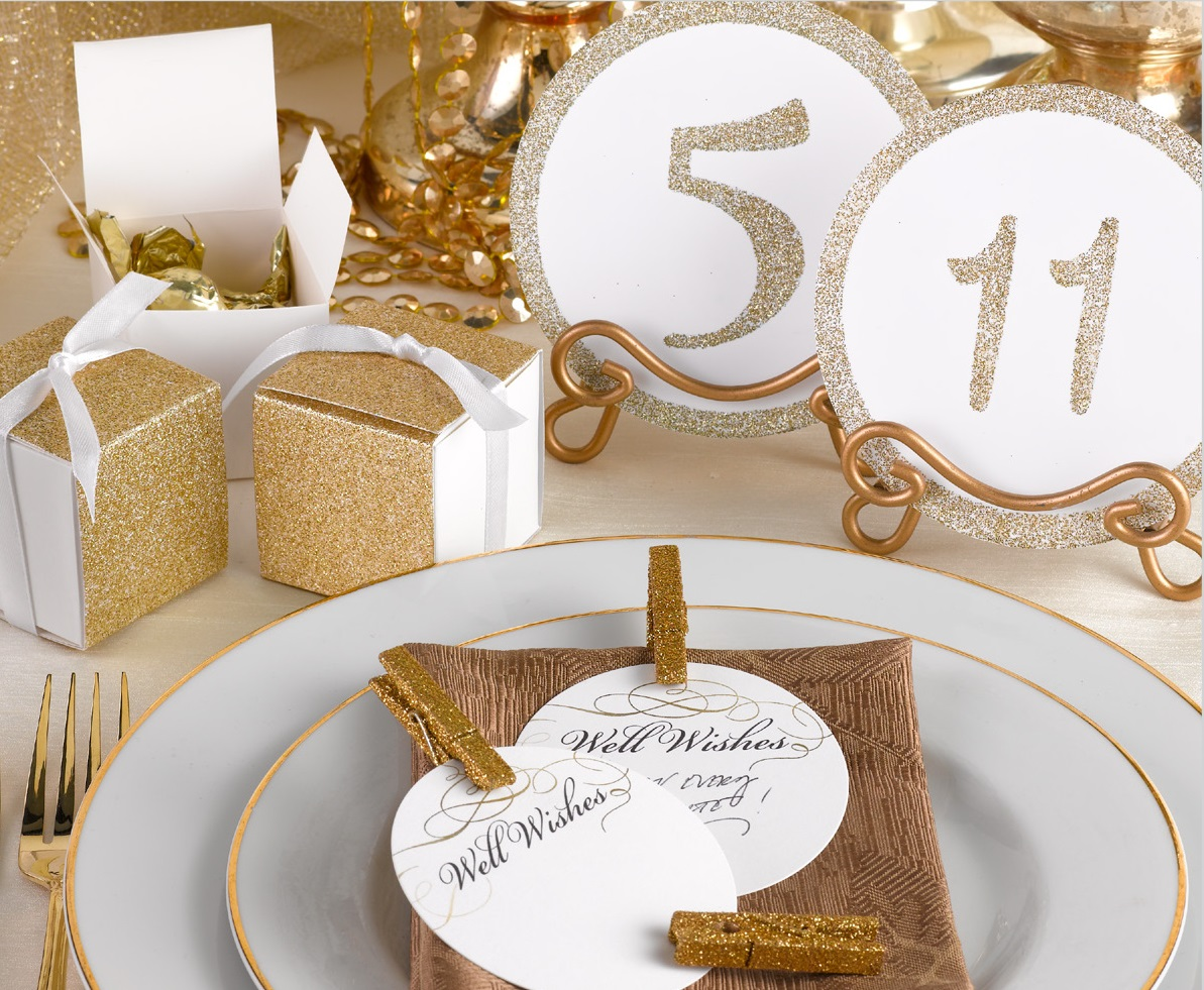 Hortense B. Hewitt Co. Collection  Clockwise from left to right:  Glitter Wrap Favor Box, Glitter Table Numbers, Mini Glitter Clothespins, Golden Elegance Advice Cards  by Carlson Craft