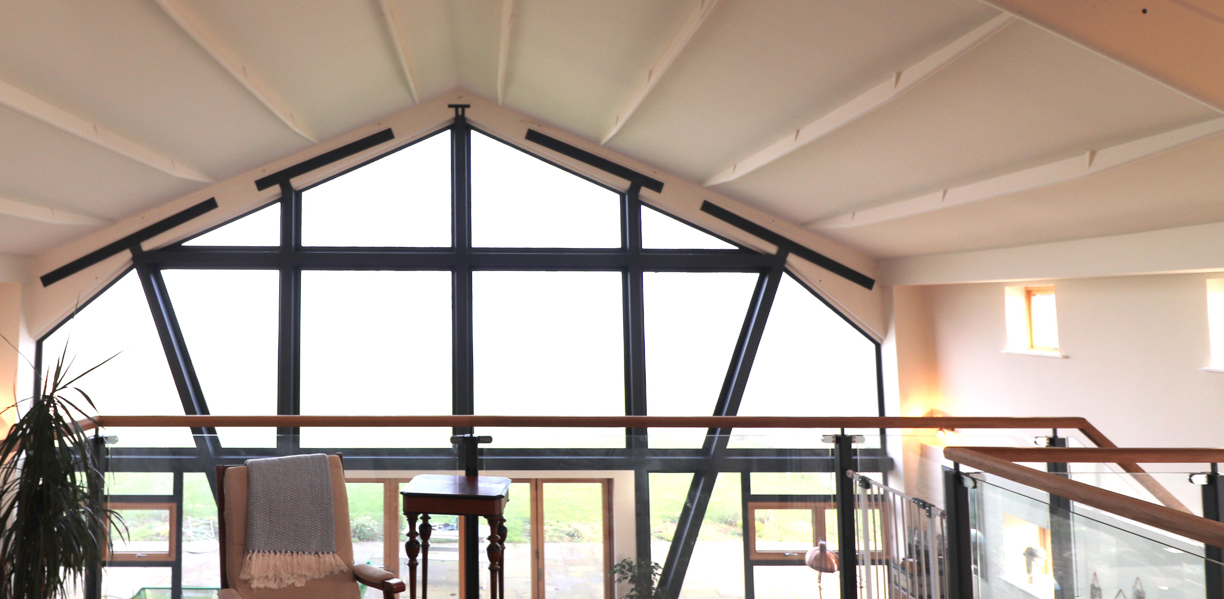 internal view of glazed gable end of barn conversion to dwelling in suffolk